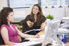 Women having an argument at work Stock Photo