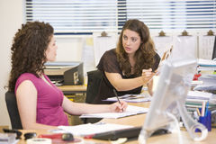 Women having an argument at work Stock Photography