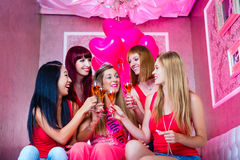 Women having bachelorette party in night club. Bride and friends celebrating hen night with champagne in club Stock Images
