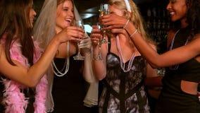 Women having a bachelorette party. In a nightclub stock video footage