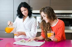 Women having breakfast and reading the newspaper Stock Images