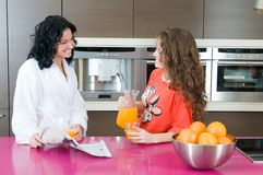 Women having breakfast and reading the newspaper Royalty Free Stock Photo