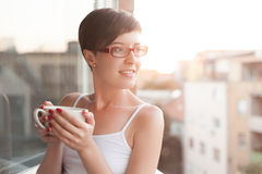 Women having a cup of coffee on balcony Royalty Free Stock Image