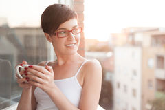 Women having a cup of coffee on balcony Stock Image