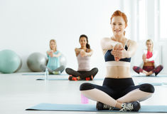 Women having fitness classes. Young sportive women having fitness classes royalty free stock photo