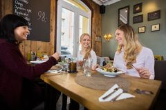 Women Having Food In Restaurant Stock Photography