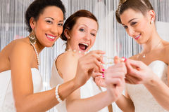 Women having fun while bridal dress fitting in shop Stock Photography