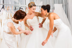 Women having fun during bridal dress fitting in shop Stock Photos