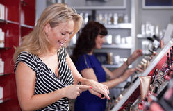 Women having fun while buying Stock Image