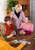 Women having fun with cards Stock Photography