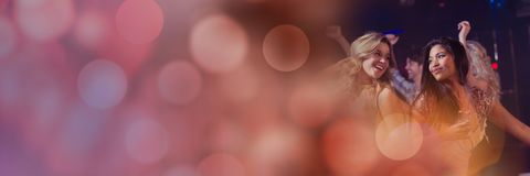 Women having fun celebration party with sparkling lights bokeh transition royalty free stock images