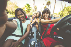 Women having fun while driving in Beverly hills. Women making shopping in Beverly hills and having fun Royalty Free Stock Images