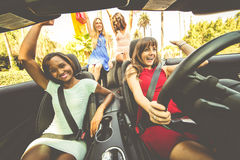 Women having fun while driving in Beverly hills Royalty Free Stock Photography