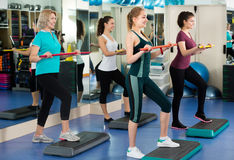 Women having group aerobic train stock photography