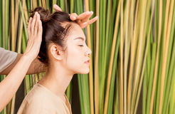 Women is having head massage relaxation. On tree background Royalty Free Stock Image