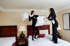Women Having Pillow Fight Stock Photo