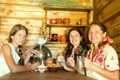 Women having tea. Three women having tea in russian traditional interior Royalty Free Stock Image