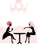 Women having tea break at the cafe Royalty Free Stock Photos