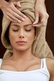 Women having treatment plucking eyebrows Stock Images