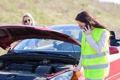 Women hawe vehicle breakdown. Beautiful young women hawe vehicle breakdown Royalty Free Stock Photos