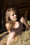 Women and hay Stock Images