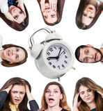 Women with a headache and alarm clock Royalty Free Stock Image