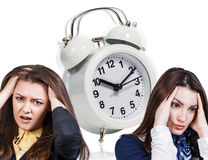 Women with a headache and alarm clock royalty free stock images