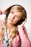 Women with headphones Stock Images