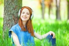 Women with headphones Stock Photography