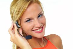 Women with headset. Young blond woman with headset stock photos