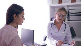 Women health, frustrated patient talking with consultant doctor in medical office. Women health, frustrated patient talking with a consultant doctor in medical stock footage