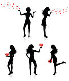 Women and heart. Royalty Free Stock Photo