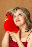 Women with a heart pillow Royalty Free Stock Photography