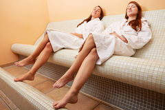 Women on heated bench resting after Royalty Free Stock Image