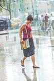 Women in heavy rain Royalty Free Stock Photo