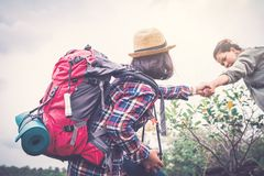 Women helping partner backpacker on holiday travel concept. Selective and soft focus,tone of hipster style stock photo
