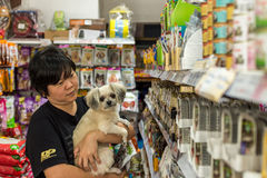 Women and her dog shop at pet shop Royalty Free Stock Image