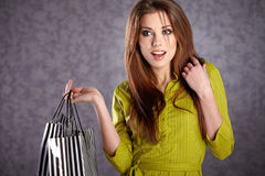 Women with her shopping bags (retro Stock Images