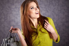 Women with her shopping bags (retro Royalty Free Stock Photography
