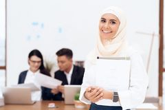 The woman in the hijab stands in the call center. royalty free stock image
