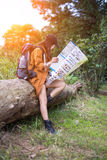 Women hiker with backpack checks map Stock Photography