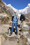 Women hikers descending steep trail. ANDES, PERU - AUG 14 - Women hikers descending steep trail in the  Cordillera Huayhuash, Andes on Aug 14, 2008, in  Peru Stock Photos