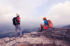 Women hikers enjoy the view on the top of great wall stock photos