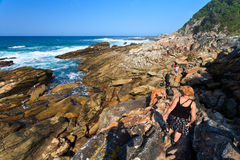 Women hiking along the Rocky coastline Stock Image