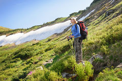 Women hiking with backpack in the mountains Royalty Free Stock Photography