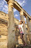 Women is history between the columns Stock Photography