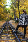 Woman hitch hiking on a rail road Stock Images