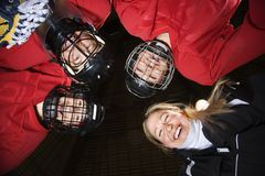 Women hockey player huddle. Royalty Free Stock Photos