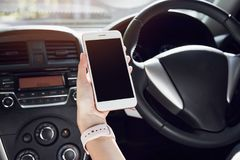 Women hoding smartphone on the car in travel trip. vacation time. Women hoding smartphone on the car in travel trip. vacation time Stock Photo