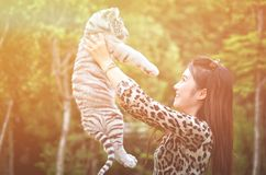 Women hold baby white bengal tiger Stock Photography